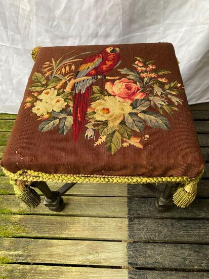 """Antique foot stool w/ needlepoint parrot scene, 17"""" tall."""