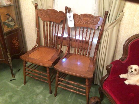 Two pressed back chairs