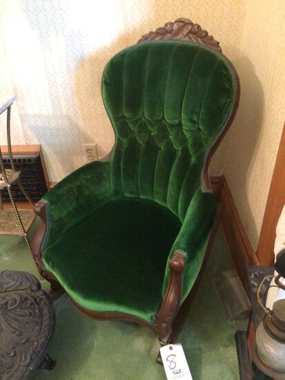 Upholstered rocking chair with carved back