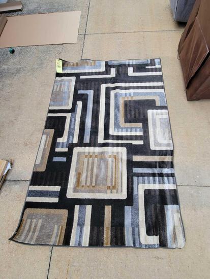 Medium woven rug 5 ft. x 7 ft. 3 in. (Tax)