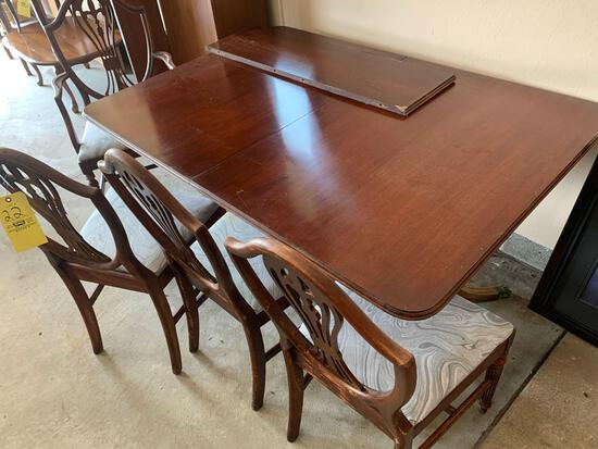 Clawfoot dinning room table with upholstered chair