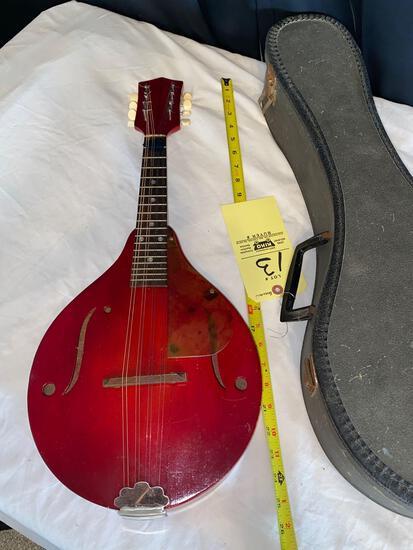 "Guitar, 25"" long. Has case. No brand name."