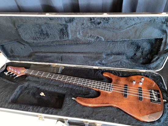 Wooden guitar w/ Carvin hard travel case.