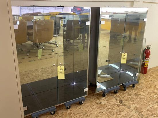 Pair of lighted glass door display cabinets w/ glass shelves.
