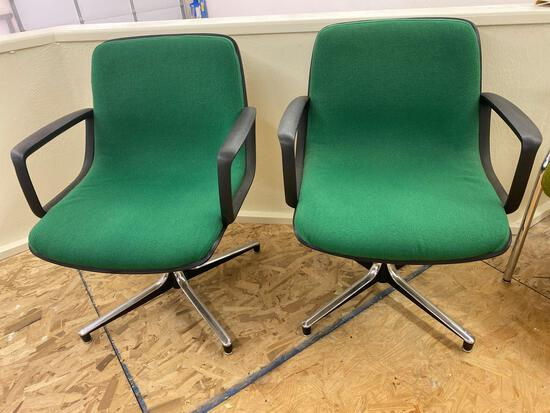 Pair swivel office chairs.