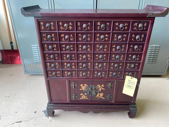 "Oriental cabinet w/ (36) drawers & dbl. door, 35"" tall x 33"" wide."