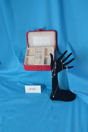 Mele and Co. suede red jewelry box and includes 2 crystal necklaces,