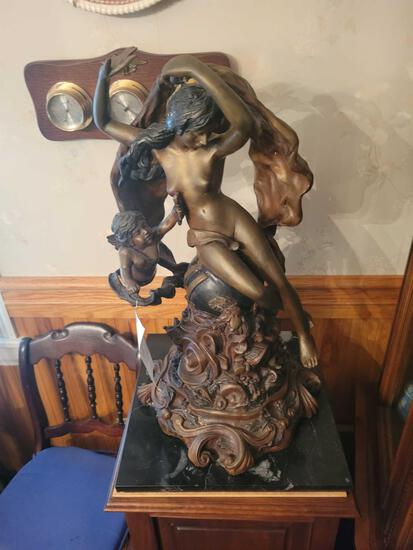 Pot metal sculpture with marble base, 26 inches tall