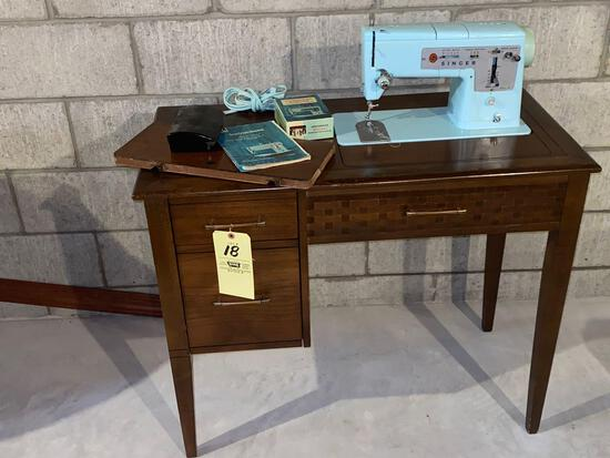 Singer Style Mate model 348 zig zag sewing machine W/ cabinet, instruction book.