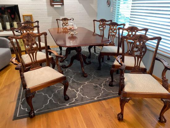 Claw footed Chippendale style dining table w/ (8) chairs, two extra leaves.