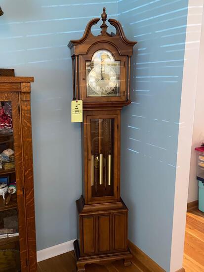 "Howard Miller grandfather clock, 78"" tall x 18"" wide."