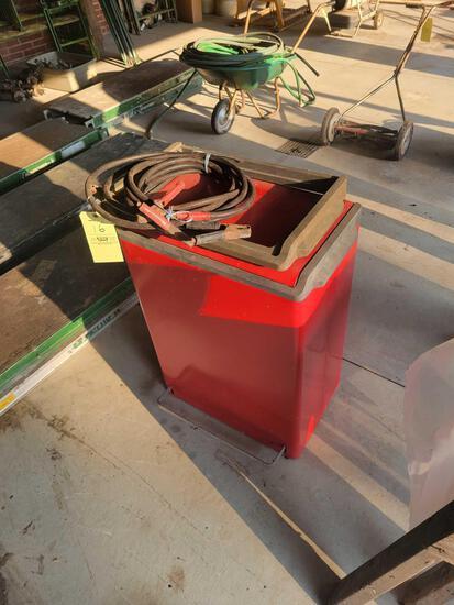 Metal trash bin, jumper cables, gas can