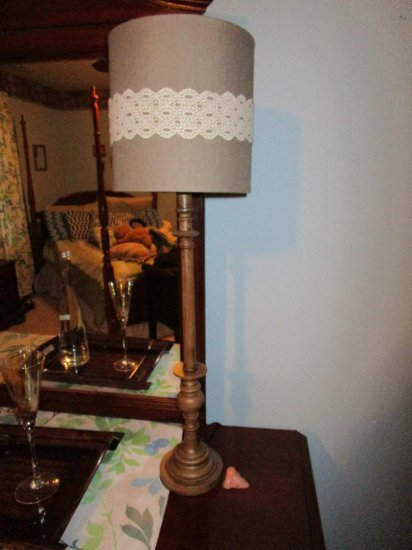 Two bedroom lamps, decorative wall decor, and small electric heater