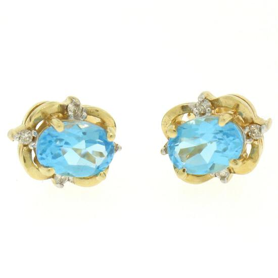14K Yellow Gold 1.18 ctw Oval Blue Topaz & Round Diamond Halo Stud Earrings