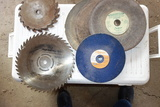 Assorted circular saw blades and grinder blades