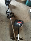 Weed Wacker with a tiller attachment