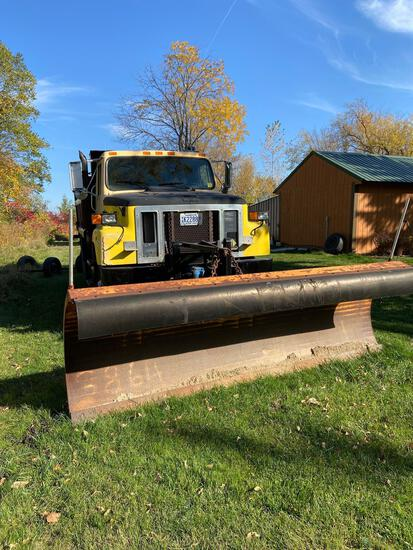 International Dump truck with snowplow and salt sander