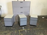 Three small filing cabinets, large file cabinet with key