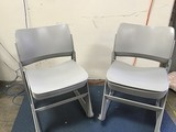 12 grey metal chairs