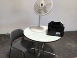 Fan ,round table, grey chair ,office  organizer