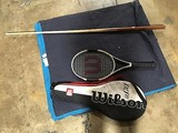 Wilson tennis racket, pool wooden cue