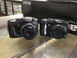 Two black canon powershot sx120 IS