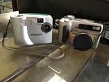 Polaroid camera, soney cyber shot digital camera