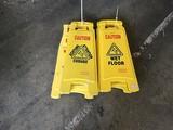 Six caution wet floor signs