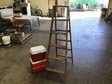 Wooden ladder with two red coolers