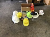 Box of construction hats and safety wear