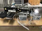 Three Nikon cool pix 1 hp camera