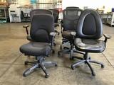 Nine black office chairs