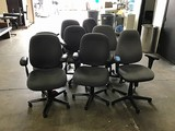 Eight grey office chairs