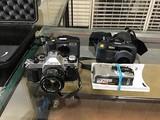 Hp photosmart camera, canon AE-1 digital camera, Two Ricoh digital cameras, storm case iM2300
