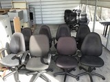 Eight black office chairs