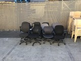 Twelve assorted office chairs