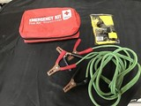 Emergency medical kit with jumper cables And climate gear weather resistant work gear