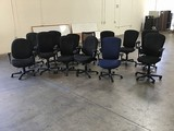 Thirteen black office chairs
