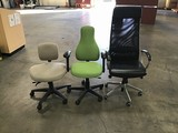 Three assorted office chairs