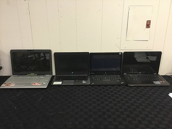 4 laptops TOSHIBA, HP, LENOVO  possibly locked, no chargers Hard drive possibly remove, some damage