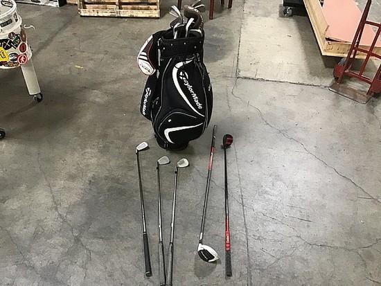 14 golf clubs in a black Taylor made golf club bag