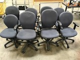 Eight blue office chairs