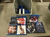Box of assorted blue ray dvd's and regular dvd's (Box not included)