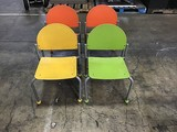 Four colored children's chairs