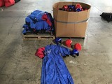 Box of skydiving helmets with pallet of indoor skydiving jumpsuits