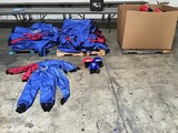 Box of skydiving helmets with two pallets of skydiving jumpsuits