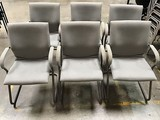 Six gray lobby chairs