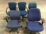 Five blue office chairs