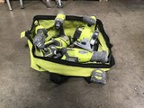 Green bag with power tools drill, saws, flashlight, measuring tape, battery