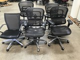 Five black office chairs